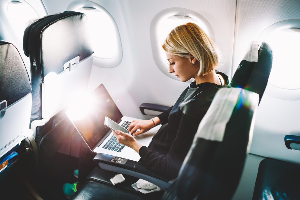 woman working while travelling