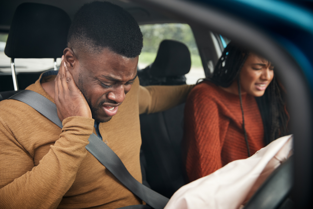 man and woman in a car accident